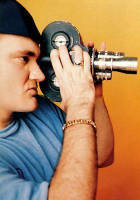Quentino Tarantino Holding Camera