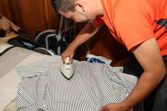 Man Ironing Clothes Shirt