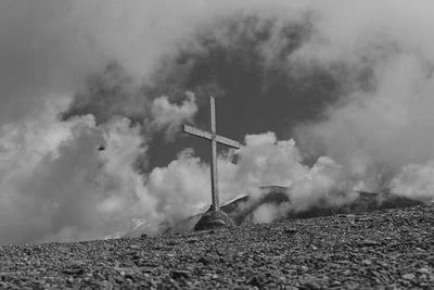 Black and white cross in clouds