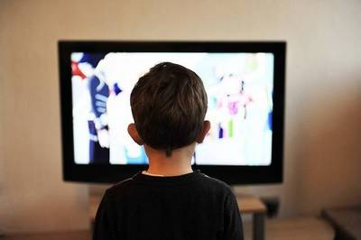Antichrist signs: Child in front of television