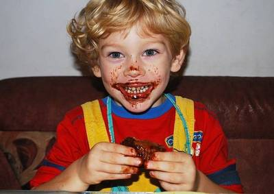 Antichrist signs: Colorful shirt boy messy eating