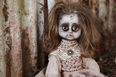 Antichrist signs: Scary horror creepy doll