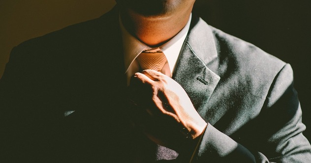 Career businessman tying a tie close-up