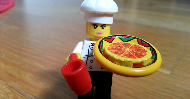 Lego chef serving Lego pizza