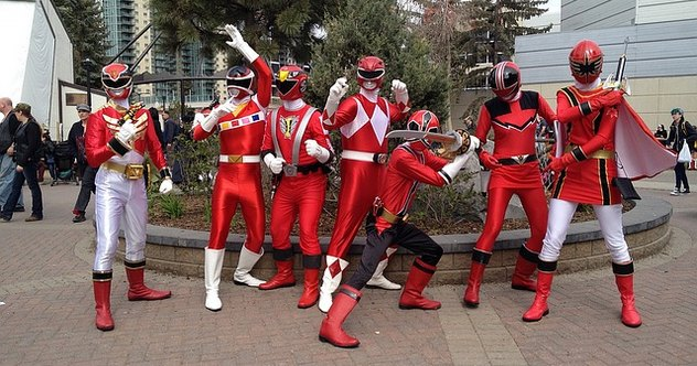 Group of people dressed as red superheroes